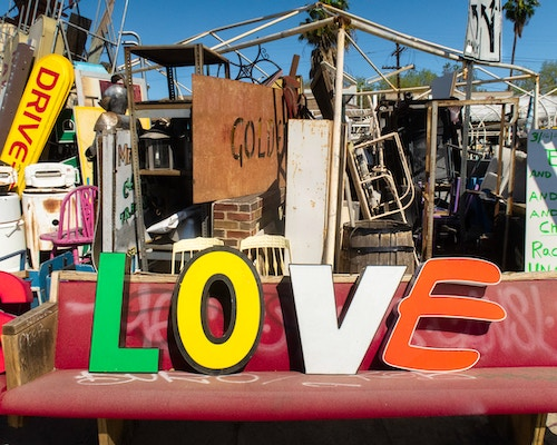 thrift store which says love and where you can find items to flip online for profit