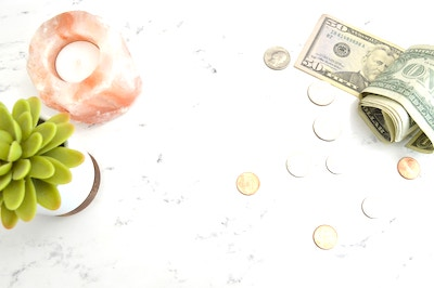 image with money and a candle - blog graphic for online micro job websites to make money online