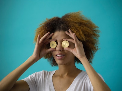 girl with coins on her eyes