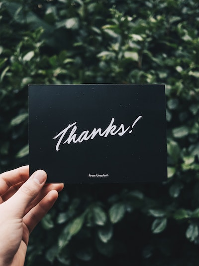 how to thank you for cash gifts - hand holding a card thank says thanks