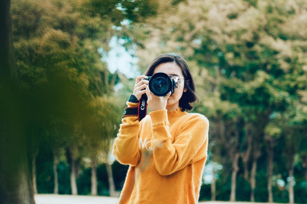 woman clicking picture. graphics for post on apps to sell photos online.
