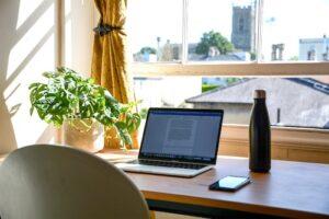 laptop on the table - post on best transcription jobs online for beginners